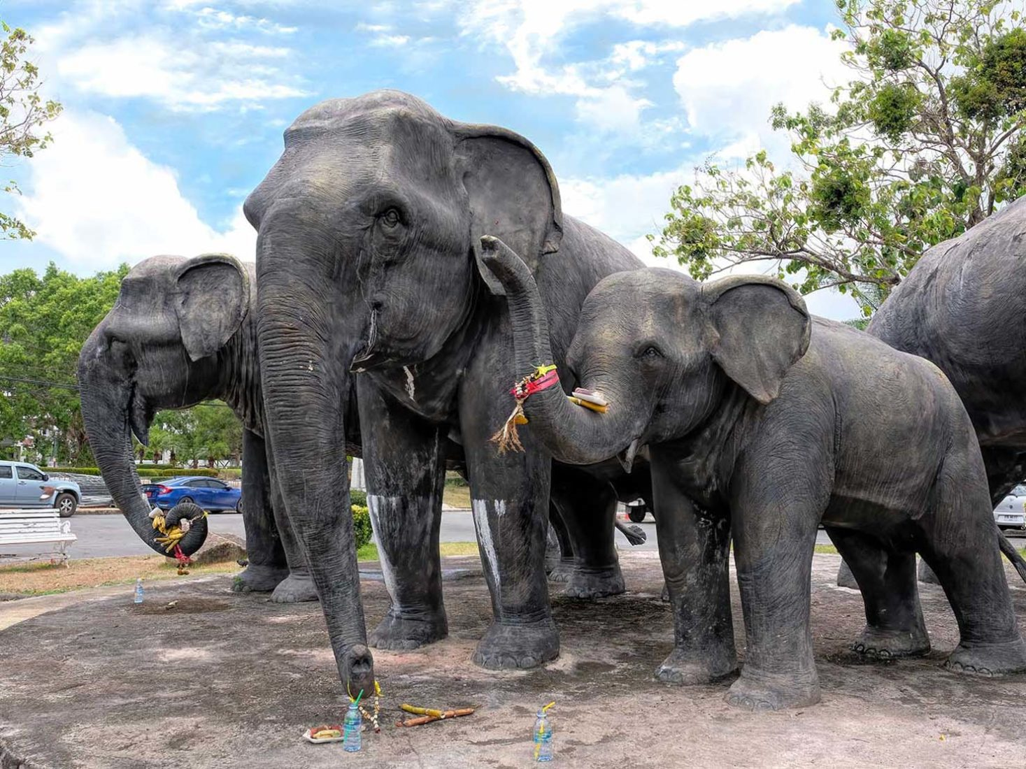 Full size sculture of an elephant herd stands in the center of a roundabout leading to Krabi city center