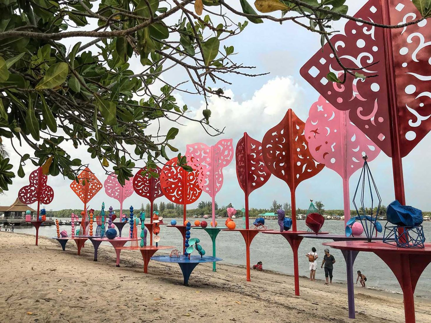 The Story of Love sculpture by Professor Emeritus Vichoke Mukdamanee on the riverfront at Thara Park in Krabi Town