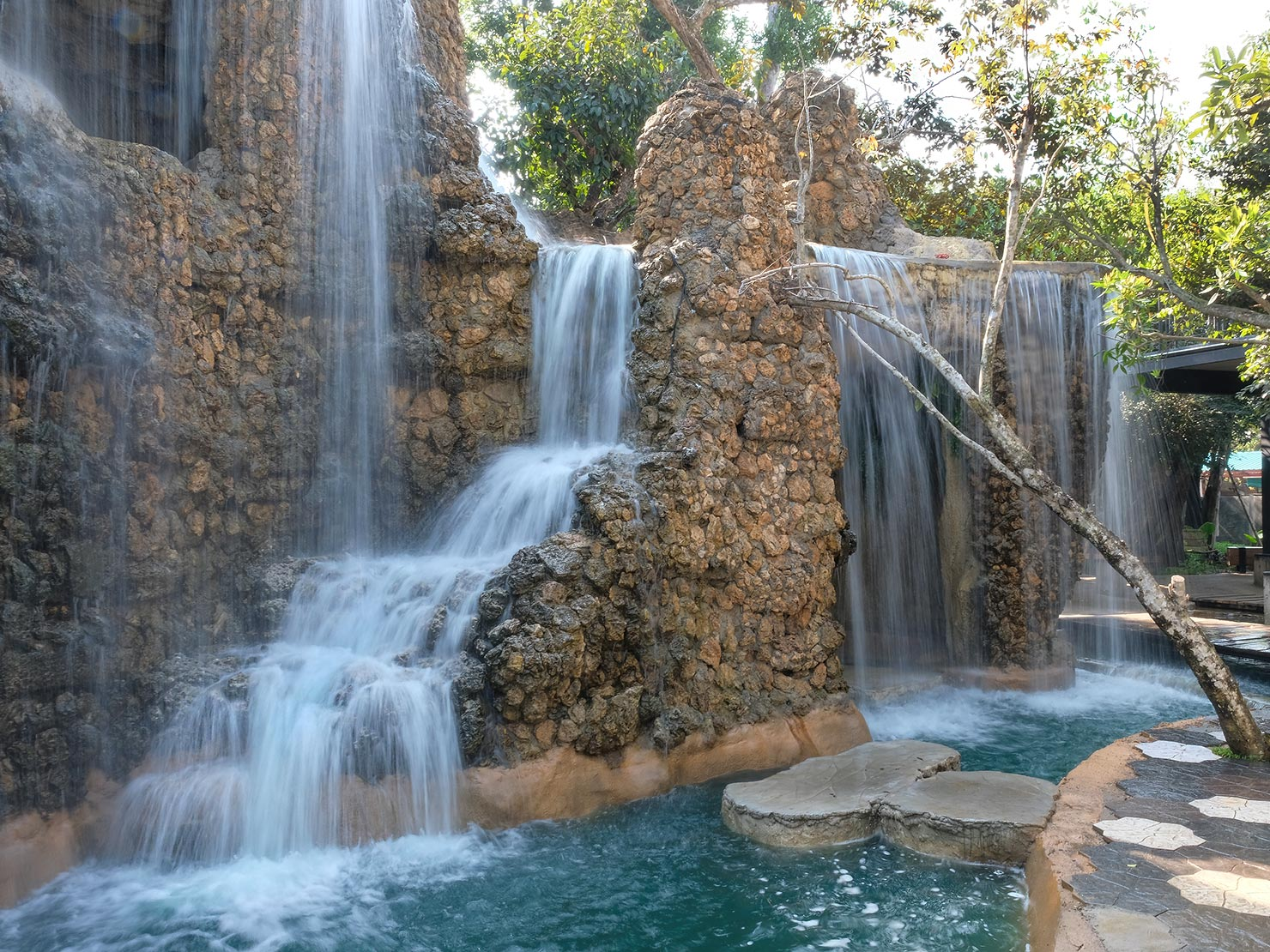 Waterfall near the entrance of Dantewada Waterfall Park provides a stunning backdrop for the coffee shop